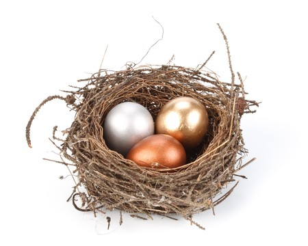 Gold, silver and bronze eggs in a real nest Stock Photo - 4507433