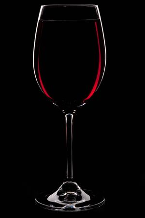 Wineglass with red wine isolated on a black background Stock Photo - 4528107