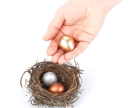 Gold, silver and bronze eggs in a real nest Stock Photo - 4534767
