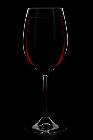 Wineglass with red wine isolated on a black background Stock Photo - 4534754