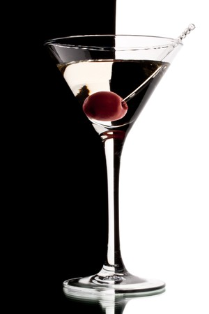 martini glass: Martini glass with cherry isolated on a black and white background.