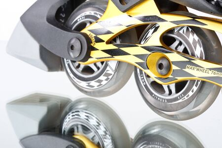 Inline skates on a white background. Close up Stock Photo - 4556778