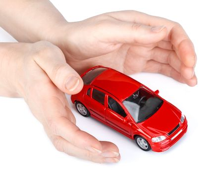 car protection: Red car in hands on a white background. Concept of safe driving Stock Photo