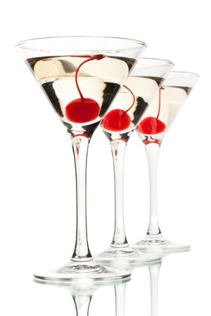 Glass of martini with cherry on a white background photo