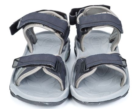 wearing sandals: Grey summer sandals on a white background