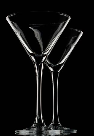 Empty glass for martini on a black background. photo