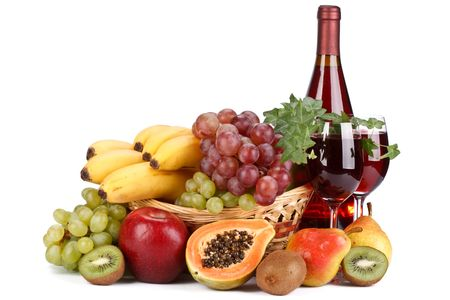 Various fresh fruits and bottle of wine on a white background photo
