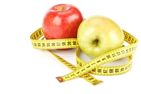 Green and red apples with measuring tape. Stock Photo - 4758333
