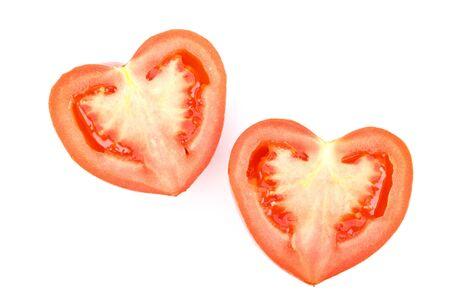 Fresh heart-shaped tomato on a white background photo