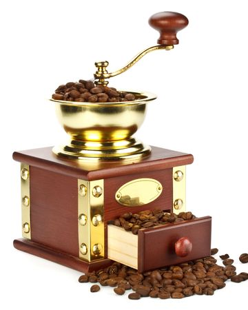 Old-fashioned coffee grinder and coffee beans on a white background photo