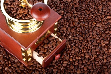 Background from old-fashioned coffee grinder and coffee beans photo