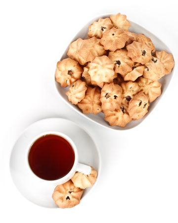 Sweet cookies and cup of tea on a white background. Close up. photo