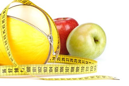 Unzipped melon, apples and measuring tape. Healthy eating concept. Close up. Stock Photo - 4837679