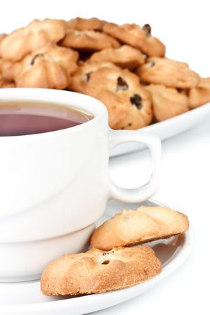 Sweet cookies and cup of tea on a white background. Close up. Stock Photo - 4837711