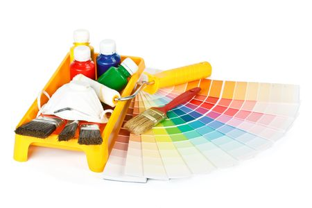 Various painting tools and color guide on a white background photo
