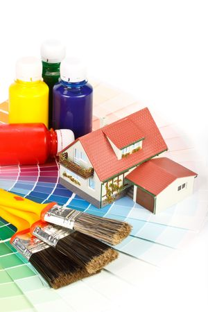 Vaus painting tools, miniature house and color guide on a white background Stock Photo - 4837714