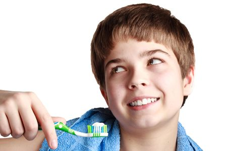 Caucasian boy cleans a teeth on a white background. Close up. Stock Photo - 4866776