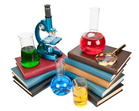 scientific literature: Pile of books, flasks, microscope and magnifier on a white background