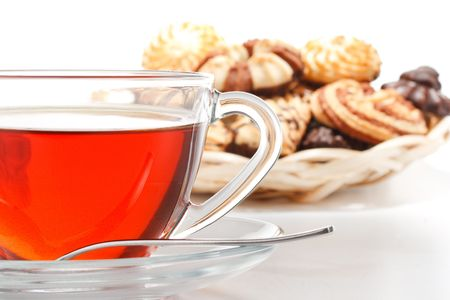 Sweet cookies and cup of tea on a white background. Close up. Stock Photo - 4879231