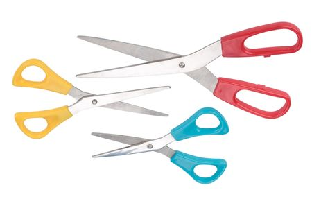 Various open scissors on a white background photo