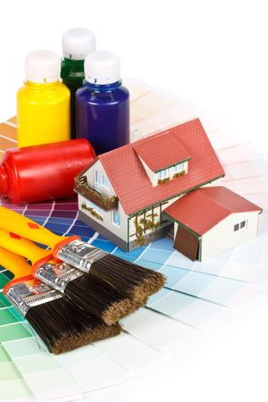 Various painting tools, miniature house and color guide on a white background Stock Photo - 4897987