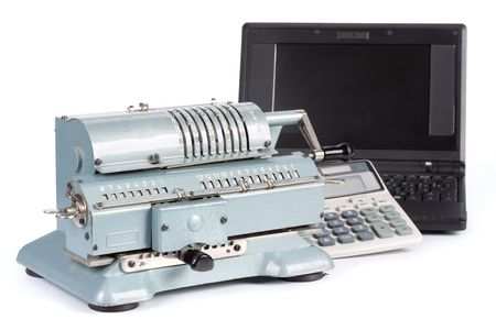 Vintage mechanical adding machine, modern calculator and notebook on a white background photo