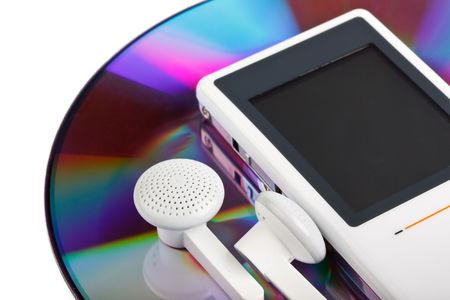 Modern MP3 player and CD disk on a white background. Close up. photo