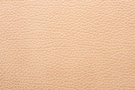creased: Natural qualitative beige leather texture. Close up.