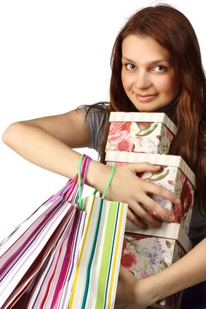 Pretty woman with shopping bags on a white background photo