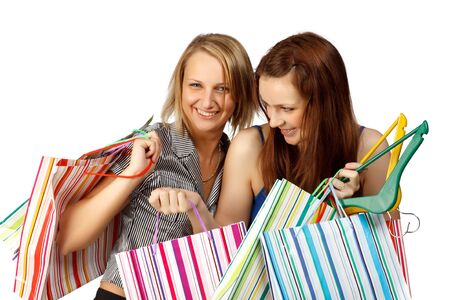 Two pretty girls discuss purchases on a white background Stock Photo - 5063671