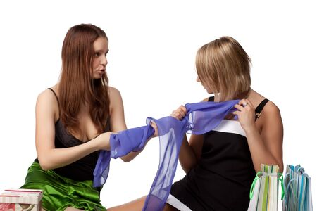Two pretty girls discuss purchases on a white background Stock Photo - 5063682