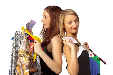 Two pretty girls with purchases on a white background photo