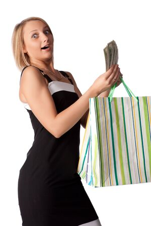 Pretty woman with shopping bags and money on a white background photo