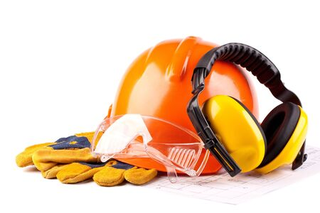 Orange hard hat, earphones, goggles and gloves on a white background photo