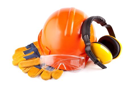 Orange hard hat, earphones, goggles and gloves on a white background Stock Photo - 5173695