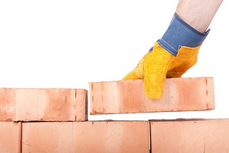 Building brick wall on a white background photo