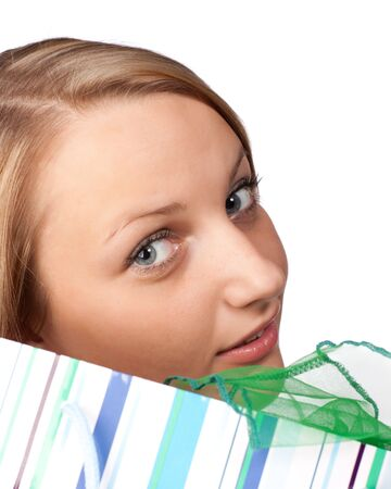Pretty woman with shopping bag on a white background photo