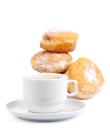Sweet donuts and cup of black coffee on a white background. Close up. photo