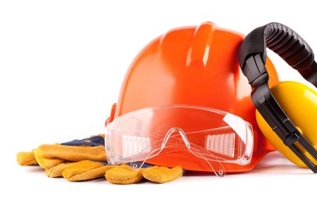 Orange hard hat, earphones, goggles and gloves on a white background Stock Photo - 5237240