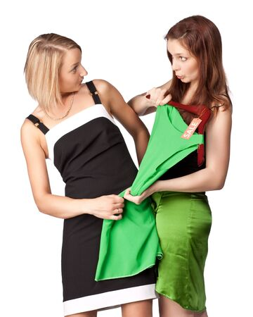 Two girls argue because of a dress. Sale. photo