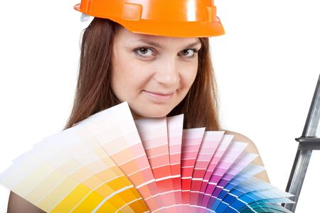 Female construction worker with palette in hands on a white background photo