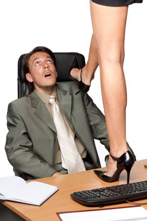 Sexual harassment. Sexy woman standing on desktop before businessman on a white background. Stock Photo - 5456128