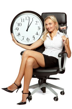 Businesswoman with knife and fork in an armchair on a white background. Lunch time. photo