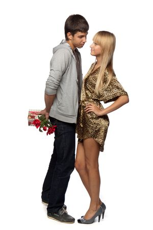 The young enamoured man gives a gift to the girlfriend on a white background. photo