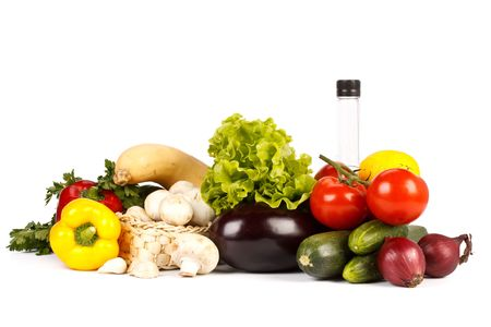 Still-life with fresh vegetables on a white background. photo
