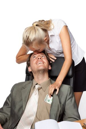 Pretty secretary pulls out money from a pocket of the businessman photo
