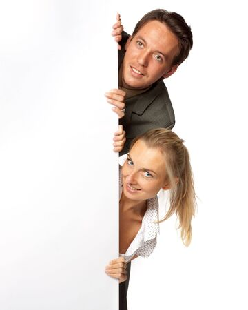 Pretty businesswoman and businessman hold an empty billboard over white background. Stock Photo - 5563831