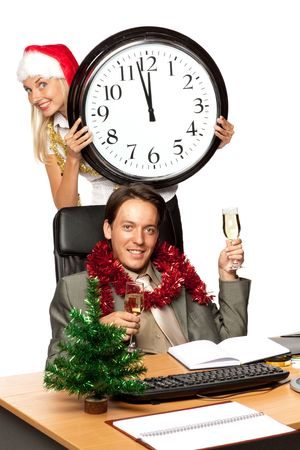 Christmas in the office. Businessman and businesswoman with champagne glasses over white background photo