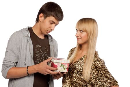 The young enamoured man gives a gift to the girlfriend on a white background. Stock Photo - 5563869