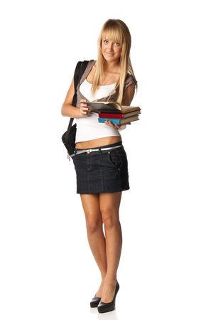 The attractive student stands with books and a bag on a white background. The student. photo